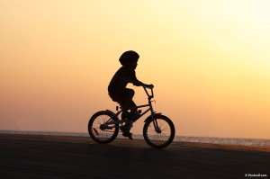 kid_on_bicycle_at_sunset-other
